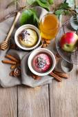 Baked apples in bowls on table close up — Foto Stock