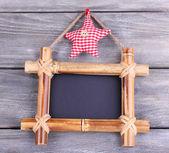 Rectangular chalkboard on wooden background — Stock Photo