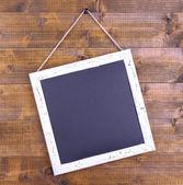 Retro chalkboard on wooden background — Stock Photo