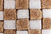 Brown and white refined sugar background — Stock Photo