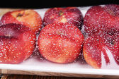 Peaches packed in food film on table close-up — Stock Photo
