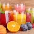 Glasses of tasty fresh juice, on wooden table. — Stock Photo #52917583