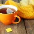 Cup of tea with tea bag on wooden table close-up — Stock Photo #52918139