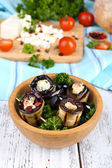 Fried aubergine in a bowl with cottage cheese, bread and parsley on a napkin on wooden background — Stock Photo