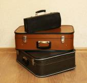 Vintage old travel suitcases on floor  — Stock Photo