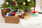 Lots of Christmas gifts on floor in festive interior — Stock Photo