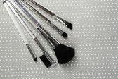 Brushes for makeup on grey background — Stock Photo