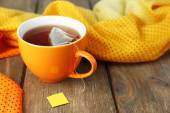 Cup of tea with tea bag on wooden table close-up — Stock Photo
