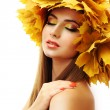 Beautiful young woman with yellow autumn wreath, isolated on white — Stock Photo #53021749