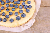 Tasty homemade pie with blueberries on wooden table — Stock Photo