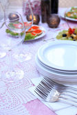 Buffet table with dishware — Stock Photo
