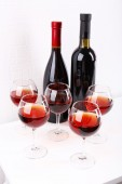Glasses and wine bottle on table in room — Foto Stock