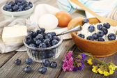 Fresh blueberries and milk products on wooden table — Foto Stock