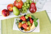 Fresh tasty fruit salad on table — Stock Photo