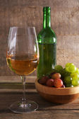 Beautiful still life with wine, cheese and ripe grape on wooden background — ストック写真