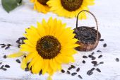Sunflowers with seeds on table close-up — Stock Photo