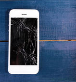 Mobile phone with broken screen — Stock Photo