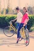 Young couple with bicycles in park — Stock Photo