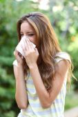 Young girl with allergy outdoors — Photo