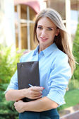 Beautiful businesswoman in dress outdoors — Foto de Stock