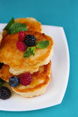 Pancake with fresh berries and mint leaf — Stock Photo