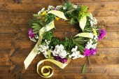 Wildflower wreath on wooden background — Stock Photo