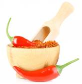 Milled red chili pepper in wooden bowl isolated on white — Stock Photo