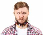 Portrait of handsome man with beard of clothespins isolated on white — Stock Photo