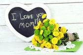 Green flowers and black board — Foto de Stock
