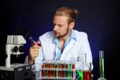 Crazy scientist working in laboratory — Stock Photo