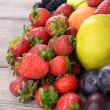 Ripe fruits and berries on wooden background — Stock Photo #53290563