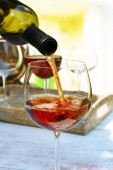 Wine pouring into glass — Stock Photo