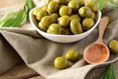 Green olives in bowl — Stock Photo