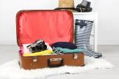 Clothes and photo camera — Stock Photo