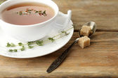 Cup of tasty herbal tea with thyme — Stock Photo