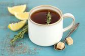 Herbal tea with thyme and lemon — Stock Photo