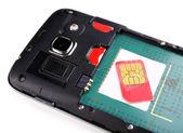 Sim card and smart phone — Stock Photo