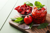 Tomatoes with basil leaves — Stock Photo