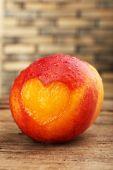 Peach with heart — Stock Photo