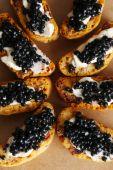 Bread with black caviar — Stock Photo