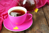 Teapot and tea bags — Stock Photo