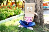 Woman with box on head — Foto Stock