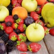 Ripe fruits and berries on wooden background — Stock Photo #53433215