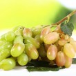 Bunch of ripe grape on wooden table on natural background — Stock Photo #53434649