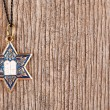 Star David pendant on wooden background — Stock Photo #53435379