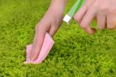 Cleaning carpet with cloth and  sprayer close up — Stock Photo