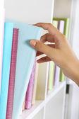 Hand picking book — Stock Photo