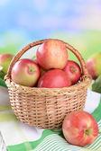 Apples in wicker basket — Stock Photo