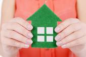 Hands holding paper house — Stock Photo