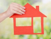 Hand holding paper house — Stock Photo
